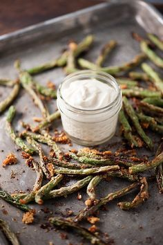 These oven roasted green beans are coated in Parmesan cheese and then dipped in a flavorful, creamy sauce!