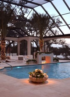 Swimming pool designs featuring new swimming pool ideas like glass wall swimming pools, infinity swimming pools, indoor pools and Mid Century Modern Pools.
