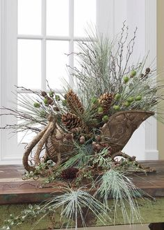 RAZ Christmas at Shelley B Home and Holiday: Christmas Sleigh Container With Pine Branch and Pine Cones
