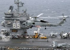 http://upload.wikimedia.org/wikipedia/commons/thumb/8/80/US_Navy_040707-N-5405H-006_An_SH-60F_Seahawk_assigned_to_the.jpg/1024px-US_Navy_040707-N-5405H-006_An_SH-60F_Seahawk_assigned_to_the.jpg