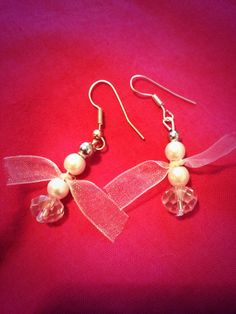 Handmade angel earrings by Black ribbon.