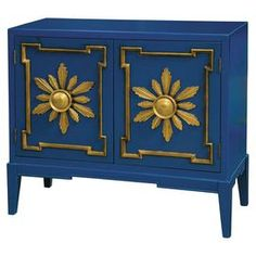 """Make a statement in your entryway or foyer with this stunning 2-door accent chest-the blue painted finish is accented the gold-hued raised doorframes and sunburst shapes.  Product: Accent chestConstruction Material: HardwoodColor: Blue and goldFeatures:  Tapered legsRaised decorative door accentsTwo doors Dimensions: 29.75"""" H x 41.5"""" W x 19"""" D"""