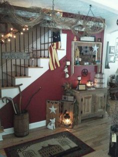 Primitive entry way with old ladder wrapped in grapevine hanging from ceiling