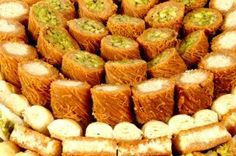 this is what real baklava looks like, they are bite size each , the crust and the filling are, crushed nuts, pine nuts and pistachios. Lebanese Desserts, Lebanese Cuisine, Lebanese Recipes, Lebanon Food, Great Recipes, Favorite Recipes, Easy Recipes, Stuffed Grape Leaves, Dessert Platter