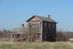 This abandoned farmhouse in western Illinois stands as a testiment of what once was a working farm.