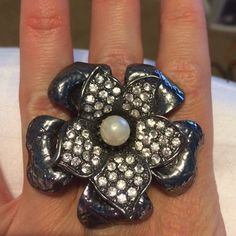 Flower ring Large rhinestone flower ring with stretch band. One size fits most. Express Jewelry Rings