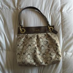 """Coach bag, like new! Cream bag, with pale pink and brown """"C""""s. Beautiful shimmery brown leather shoulder strap. Also comes with an optional second longer strap to make it a cross-body bag! Tiny spot in bottom, shown in photo. Coach Bags Shoulder Bags"""