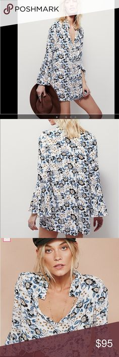 Free People Magic Mystery Printed Tunic. Not worn Free People Magic Mystery Printed Tunic. Washed once but never worn. Beautiful printed tunic with exposed button detailing down the front with a V-neckline and ruffled collar. Long sleeves with statement flared cuffs. Color is ivory.   This versatile top can also be worn as a mini dress.  *84% Rayon *16% Viscose Free People Tops Tunics