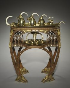 designed by Carlo Bugatti (Italian, 1856-1940)  inlaid wood (mahogany?), cast and gilded bronze mounts, inlays of ivory or bone, metal, and mother-of-pearl (marine mussels or pearl oysters), Overall - h:71.50  w:67.10  d:41.30 cm (h:28 1/8  w:26 3/8  d:16 1/4 inches). Leonard C. Hanna, Jr. Fund 1991.45