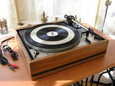 Dual 1229Q rim drive 3-speed changer was the equal of many high end turntables.
