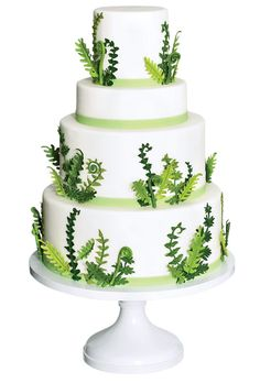 Brides.com: Style Inspiration: Casual, Woodsy Wedding Cake, $12 per slice (serves 60), Elegantly Iced.  See more green wedding cakes.