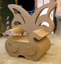 Art Ed Central loves: Fairy cardboard chair with backrest in the shape of butterfly wings ~~ W O W This website has THE most amazing cardboard Furniture ,,,M Cardboard Chair, Cardboard Recycling, Diy Cardboard Furniture, Paper Furniture, Cardboard Sculpture, Cardboard Paper, Cardboard Crafts, Funky Furniture, Unique Furniture