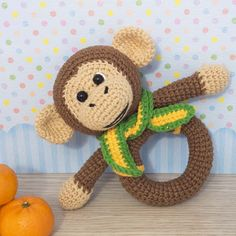 This crochet monkey rattle is sure to become one of baby's favorites! It provides a wonderful way to help develop baby's motor skills. One important note before you start following this rattle crochet pattern – toys with small plastic parts should not be given to children under the age of 3!
