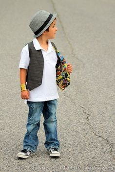 """This reversible vest was a total hit with my boys!  Not only do they love to dress up and accessorize but they also love Superheros!!!  So it was a win, win for us.  Business on the outside, party on the inside.  Materials: 1 meter of plain fabric 1 meter of """"party"""" …"""