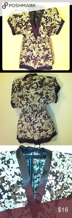 Apt9, 1X blouse,brown, biege, white, low-v-neck 95% polyester, 5%spandex, semi sheer, no under garment built in, 1inch wide waist elastic strip, dolman style sleeves , 20 inches + across shoulder measurements, low V neck opens to waist, sleeve length- to elbows, bust- 20 inches across +, full body length from shoulders down to bottom hem- 32 inches long, ladies regular 1X size blouse, brown, white, beige, with leaves, my favorite blouse, I do love this top, didn't want to let go, but it's…