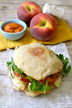 Top your turkey sandwich with peaches, arugula, and spicy mayonnaise.  Get the recipe at Lemon Tree Dwelling.