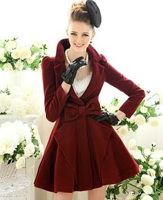 Christmas or Thanksgiving, or any day of the week, would be a holiday in this wine colored swing woolen coat!