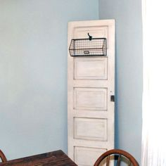 Add instant warmth and character to your home with this DIY antiqued vintage door! Tutorial on the blog.