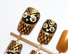 Vintage Owls - 12 handpainted gold/black owl nails with rhinestone eyes. €25.00, via Etsy.