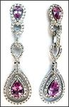 Our beautiful 18k white gold dangling pink sapphire and diamond earrings feature 1.36ct in pink sapphire. .72ct in G color VS1 clarity diamonds compliment the pink sapphire on these dangling ladies earrings.