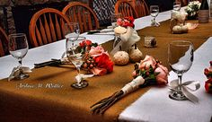 Wedding table decorated with burlap, miniature  pumpkins and  bridesmaid bouquets