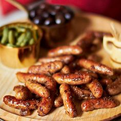 Mustard and Ginger Cocktail Sausages. Four ingredients transform smoked cocktail sausages are into crowd-pleasing party snacks. Yummy Appetizers, Appetizers For Party, Appetizer Recipes, Snack Recipes, Cooking Recipes, Fall Recipes, Party Recipes, Sausage Recipes, Party Snacks