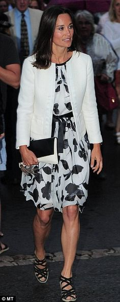 Pippa Middleton leaves Centre Court at Wimbledon on Thursday after watching from the Royal Box as Rafael Nadal beat Lukas Rosol