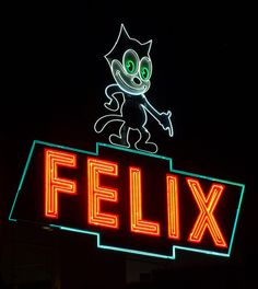 One of my favorite neons in town, Felix the Cat (1959) points the way to a brand new Chevrolet! Figueroa St. in Los Angeles.