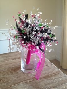 Clear, Green, & Pink Crystal Bouquet with Black Feathers & a Pink wrapped stem! www.crystalbloomweddings.com  Follow us on Instagram: @crystalbloomweddings
