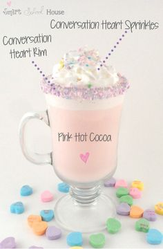 Conversation Heart Cocoa*White Hot Cocoa with a drop of red coloring.Put syrup on rim of glass & dip in crushed conversation hearts.Color cocoa & top with whipped cream & crushed conversation hearts.