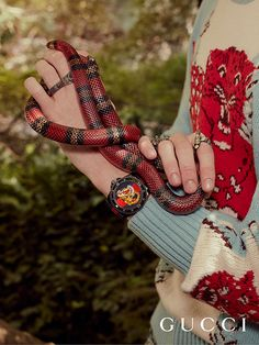 Discover more gifts from the Gucci Garden by Alessandro Michele. The tiger embroidered Gucci Dive watch from Gucci Gift.