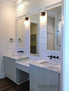 The shiplap and makeup vanity.   Master bathroom. I would add more lights on the mirror wall.