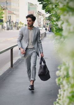 Pale Blue Poplin Suit, and Black Loafers and Bag, Men's Spring Summer Street Style Fashion.