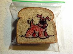 Sandwich Bag Art (This dad must meet the mom who draws super-powered canines on her son's lunchbox napkins!)