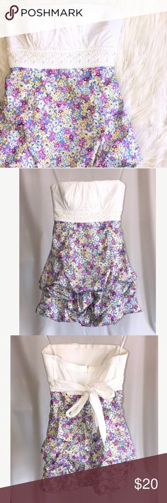 "White & Purple Floral Cotton Strapless Dress White cotton stretch Strapless dress with crocheted banded waist.  Lightly padded bust.  Back tie.  Floral skirt in shades of purple, yellow and blue.  Skirt is gathered underneath. Fully lined.  Back zipper.  Size juniors 5.  Pit to pit laying flat 15.5"", length approx 24-25"".  Waist 13.75"".  97% cotton/3% spandex.  Machine wash cold. In excellent condition.  Worn only a few times. Sequin Hearts Dresses Mini"