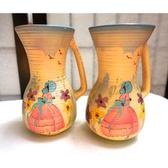 VINTAGE POTTERY JUGS Matched pair, made in Holland, hand painted. (445 ILS) ❤ liked on Polyvore featuring home and home decor