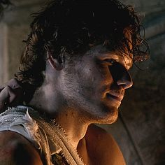 Jamie at Castle Leoch, with Claire treating his bullet wound.