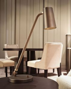 Forget haute couture fashion. This is haute couture lighting with a luxurious silk rope trim. Find out more about this superb table lamp at: http://www.italian-lighting-centre.co.uk/contemporary-metal/contardi-bronze-chrome-table-light-with-silk-rope-detail-p-8400.html#.VVYnuflViko