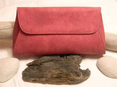 Only $42 for this pink reptile print clutch - pretty much love the COLOR!  www.scoutandmollys.com