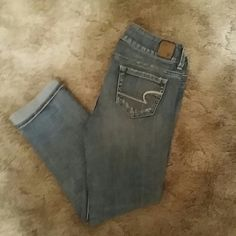 American Eagle Light Wash Capris Worn a handful of times and in good condition! All of the distressed denim is intentional and was bought that way. These are Artist style capris. Size 0 regular. American Eagle Outfitters Jeans