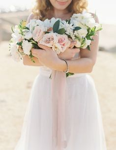 Pretty bouquet: http://www.stylemepretty.com/2015/04/04/seaside-wedding-at-sunset-cliffs/ | Photography: Carmen Santorelli - http://carmensantorellistudio.com/