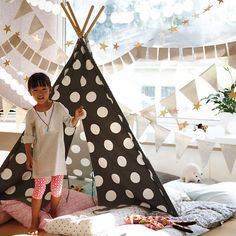 Polka dotted teepee? Fun cloth banner?? This room is my childhood dream come true.