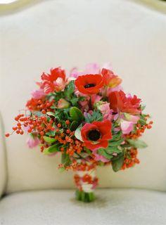 Bouquet of anemone, sweetpeas, tulips + ilex berries