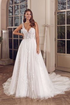 Be playful in this shimmery ball gown. Beading and embroidered lace decorate the illusion bodice and back. The skirt has sequins and lace with a sparkle tulle underlay that will make you unforgettable. This style is available with a raised neckline option and also available with the bodice lined to the back.