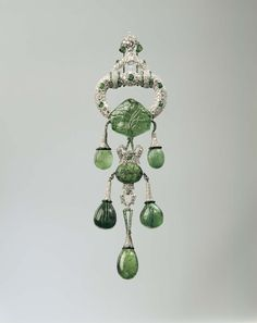 "Cartier 1928 platinum pendant brooch with emeralds, diamonds and enamel. Worn by Marjorie Merriweather Post as part of her ""Juliet"" fancy dress outfit for the Palm Beach Everglades Ball in 1929. Image: Courtesy Hillwood Estate, Museum and Gardens."