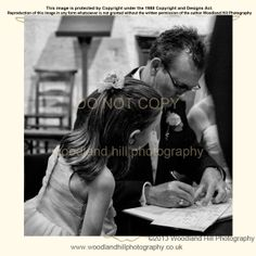 Wedding photography and capturing the documentary moments during a wedding.  This is the signing of the register with a little helper :)