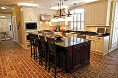 Rustic home design employs a whole lot of burnt brick walls, wooden flooring and provides the wall color shades of brown to make an earthy impression. With sleek decor and tasteful touches, contemp… Brick Floor Kitchen, Kitchen Flooring, Rustic Home Design, Rustic Decor, Brick Flooring, Flooring Ideas, Mediterranean Home Decor, Up House, Kitchen Design