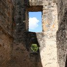 View through a window at the San Antonio Mission.