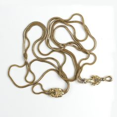 A Victorian 9ct. yellow gold muff chain the uniform snake link chain with clasped gloved hand support to the swivelling… / MAD on Collections - Browse and find over 10,000 categories of collectables from around the world - antiques, stamps, coins, memorabilia, art, bottles, jewellery, furniture, medals, toys and more at madoncollections.com. Free to view - Free to Register - Visit today. #Jewelry #Chains #MADonCollections #MADonC