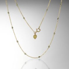 Delicate femininity is ever-present in this Me&Ro diamond necklace. The 18K yellow gold chain holds grey diamond beads that send out just enough sparkle to carry you through day or night. Layer it with your other favorites for an added element of modern elegance. @QUADRUM